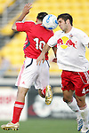 28 March 2007: New York's Carlos Mendez (4) wins a header against Toronto's Alecko Eskandarian (10). Toronto FC defeated the New York Red Bulls 2-1 at Blackbaud Stadium in Cary, North Carolina in the 2007 Carolina Challenge Cup.