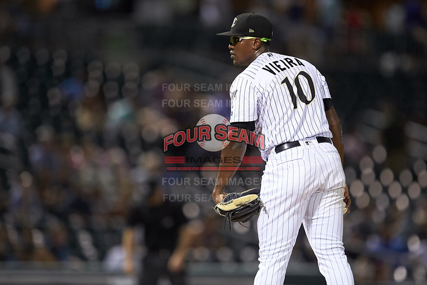 Charlotte Knights relief pitcher Thyago Vieira (10) looks to his catcher for the sign against the Scranton/Wilkes-Barre RailRiders at BB&T BallPark on August 14, 2019 in Charlotte, North Carolina. The Knights defeated the RailRiders 13-12 in ten innings. (Brian Westerholt/Four Seam Images)