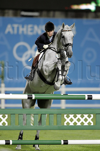 18 August 2004: German rider Bettina Hoy (GER) on Ringwood Cockatoo jump a fence during the Eventing Showjumping Final held at the Markopoulo Olympic Equestrian Centre. Hoy won gold on the night but following a decision by the Court of Arbitration for Sport Bettina Hoy was handed 12 penalties for crossing the start line twice during her 1st round. This promoted Law to gold, Severson to silver and Funnell to bronze, Hoy moved to 9th overall after the decision. 2004 Olympic Games, Athens, Greece. Photo: Neil Tingle/Action Plus..040818 olympics olympic showjumping horse horses showjumper showjumpers equestrian sport sports jumping jumper jumps show three-day event three day events 3-day 3 day eventing eventer eventers celebrations celebration celebrates celebrate joy celebrating