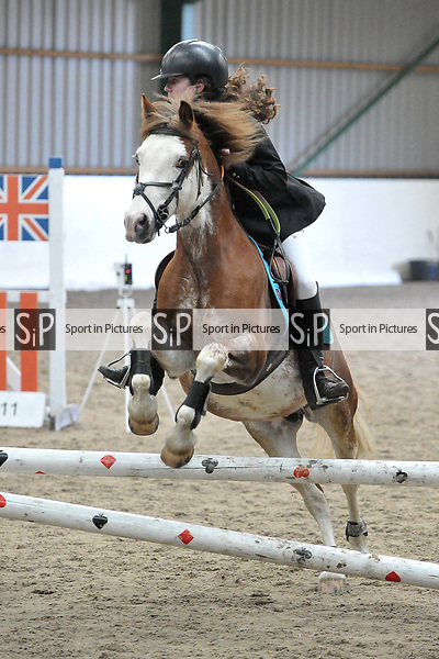 Class 4. 65cm. New year unaffiliated showjumping. Brook Farm Training Centre. Stapleford Abbotts. UK. 06/01/2018. ~ MANDATORY CREDIT Garry Bowden/Sport in Pictures - NO UNAUTHORISED USE - +44 7837 394578