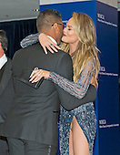 Chrissy Teigen hugs Seattle Seahawks quarterback Russell Wilson as they arrive on the Red Carpet for the 2015 White House Correspondents Association Annual Dinner at the Washington Hilton Hotel on Saturday, April 25, 2015.<br /> Credit: Ron Sachs / CNP