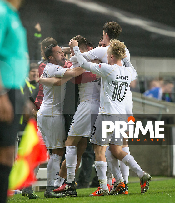 The team celebrate Ryan Colclough of Milton Keynes Dons goal with MK Dons Caretaker Manager Richie Barker  during the Sky Bet League 1 match between MK Dons and Chesterfield at stadium:mk, Milton Keynes, England on 22 November 2016. Photo by Andy Rowland.