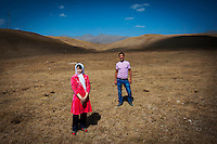 18 year old Aitilek and her husband, Baktiyaf, who she was kidnapped by the day after they met in Bishkek. Although illegal, bride kidnapping is common in rural parts of Kyrgyzstan. Although illegal, bride kidnapping is common in rural parts of Kyrgyzstan. Each year around 16, 000 women become married after being kidnapped. They are known as 'Ala Kachuu' that translates as 'to grab and run away'. Defenders of the continuation of the practice sight tradition. However, during Soviet Times it was rare, and parents generally arranged marriages.
