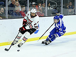 SIOUX FALLS, SD - MARCH 23: Luke Jaycox #6 from St. Cloud State University pushes the puck past Walker Sommer #42 from Air Force during their game at the 2018 West Region Men's NCAA DI Hockey Tournament at the Denny Sanford Premier Center in Sioux Falls, SD. (Photo by Dave Eggen/Inertia)