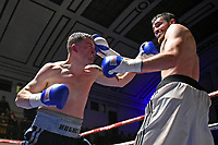 Jamie Hughes (black shorts) defeats Callum Ide during a Boxing Show at York Hall on 10th February 2018