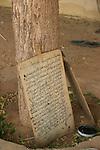 Wooden tablets with coranic versets displayed outside the house of the marabout in Maradi, Niger. In Niger, coranic schools still exist and are very traditional. Talibe, pupils, even go and beg for money and food in the afternoon in order to pay the marabout.