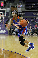 SEATTLE, WA - DECEMBER 18: Savannah State's #2 Kenyata Hendrix brings the ball down court against Washington.  Washington won 87-36 over Savannah State at Alaska Airlines Arena in Seattle, WA.