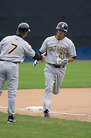 June 1, 2008: Salt Lake Bees' Freddy Sandoval gets a handshake from Manager Bobby Mitchell after stroking a three-run homer against the Tacoma Rainiers at Cheney Stadium in Tacoma, Washington.