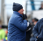 Ally McCoist enjoying banter with the home fans as he bites the finger on his glove for a laugh
