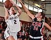 Ashleigh Sheerin #2 of North Shore, left, looks to drive to the net as Jen Rosenberg #34 of Cold Spring Harbor defends her during the Nassau County varsity girls basketball Class A quarterfinals at North Shore High School in Glen Head, NY on Wednesday, Feb. 22, 2017. North Shore won by a score of 74-46.