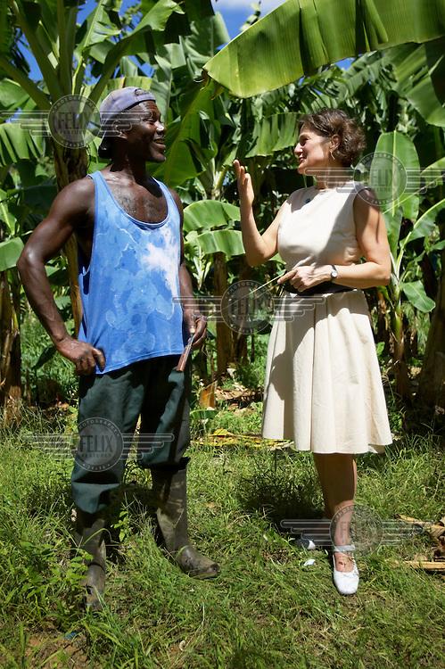 Fairtrade Foundation Director Harriet Lamb speaks with a banana farmer.