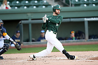 Third baseman Zach Iverson (32) of the Michigan State Spartans bats in a game against the Merrimack Warriors on Saturday, February 22, 2020, at Fluor Field at the West End in Greenville, South Carolina. The Merrimack catcher is Wyatt Villella (17). Merrimack won, 7-5. (Tom Priddy/Four Seam Images)