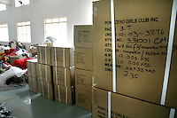 Finished garments packed in a box for export  at Popy's Industry's garment stitching factory in Tirupur, Tamilnadu. After lifting of quota system in textile export on 1st january 2005. Tirupur has become the biggest foreign currency earning town of India.