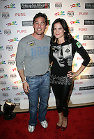 DEAN CAIN & TIFFANY MICHELLE.The Ante Up for Africa Celebrity Poker Tournament at the Rio Resort Hotel and Casino, Las Vegas, Nevada, USA..July 2nd, 2009.full length leggings black top red shoes hand on hip jeans denim grey gray.CAP/ADM/MJT.© MJT/AdMedia/Capital Pictures