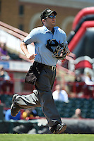 Home plate umpire Blake Felix gets into position during a game between the Akron RubberDucks and Erie SeaWolves on May 18, 2014 at Jerry Uht Park in Erie, Pennsylvania.  Akron defeated Erie 2-1.  (Mike Janes/Four Seam Images)