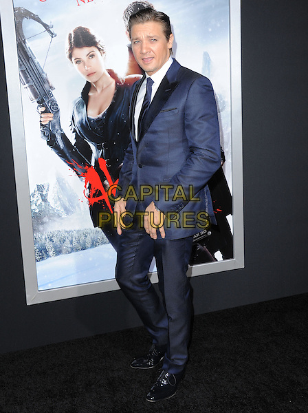 Jeremy Renner.attending the Paramount Los Angeles film premiere of 'Hansel and Gretel: Witch Hunters', held at The Grauman's Chinese Theater in Hollywood, California, USA, January 24th 2013..full length navy blue suit tie white shirt                                        .CAP/DVS.©Debbie VanStory/Capital Pictures.