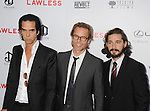 HOLLYWOOD, CA - AUGUST 22: Nick Cave, Guy Pearce and Shia LaBeouf arrive at the 'Lawless' Los Angeles Premiere at ArcLight Cinemas on August 22, 2012 in Hollywood, California. /NortePhoto.com....**CREDITO*OBLIGATORIO** *No*Venta*A*Terceros*..*No*Sale*So*third* ***No*Se*Permite*Hacer Archivo***No*Sale*So*third*