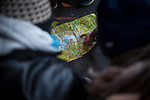 A volunteer shows some African migrants where the border is in a map in the main square. Irun (Basque Country). November 8, 2018. A group of volunteers has created a host network to serve migrants and inform about the public services they are entitled to and the ways to cross the border. This group of volunteers is avoiding a serious humanitarian problem Irun, the Basque municipality on the border with Hendaye. As the number of migrants arriving on the coasts of southern Spain incresead, more and more migrants are heading north to the border city of Irun. French authorities have reacted by conducting random checks as far as the city of Bordeaux, more than 200 kilometers north of the border. Migrants who are caught are then deported back to Irun. (Gari Garaialde / Bostok Photo).