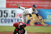 Jamestown Jammers shortstop Noah Perio attempts a double play over Jon Rodriguez during a game vs. the Batavia Muckdogs at Dwyer Stadium in Batavia, New York July 31, 2010.   Batavia defeated Jamestown 6-1.  Photo By Mike Janes/Four Seam Images