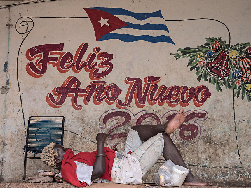 A woman resting at a market, Vedado, La Habana