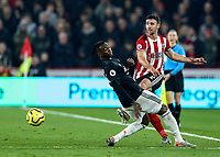 24th November 2019; Bramall Lane, Sheffield, Yorkshire, England; English Premier League Football, Sheffield United versus Manchester United; Enda Stevens  of Sheffield United passes the ball with Aaron Wan-Bissaka of Manchester United trying to block the pass - Strictly Editorial Use Only. No use with unauthorized audio, video, data, fixture lists, club/league logos or 'live' services. Online in-match use limited to 120 images, no video emulation. No use in betting, games or single club/league/player publications
