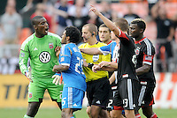 D.C. United goalkeeper Bill Hamid (28) argues with Philadelphia Union Sheanon Williams (25) after Sheanon Willimas gets a red card and did not want to leave the field  while main referee Mark Geiger tries to control the situation.  D.C. United tied The Philadelphia Union 1-1 at RFK Stadium, Saturday August 19, 2012.
