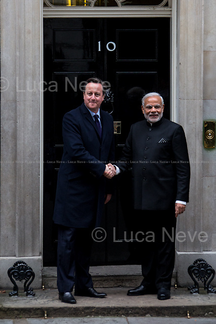 (From L to R) David Cameron and Narendra Modi. <br /> <br />  London, 12/11/2015. Today, the Prime Minister of India Narendra Modi (Leader of the Bharatiya Janata Party, BJP; former Chief Minister of Gujarat from 2001 to 2014; actual Member of Parliament from Varanasi) met the British Prime Minister David Cameron at 10 Downing Street during his visit to the UK. After the meeting, the two Prime Ministers went to Parliament Square (cleared from traffic and members of the public) to pay tribute to the Mahatma Gandhi statue and to see the Red Arrows performing a flypast over Westminster. In the meantime, Sikh and Kashmir people protested patrolled by heavy police presence.