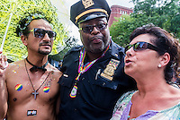 New York, NY- Gay Pride Parade in the West VIllage - Officer Hicks with Parade Goers on Greenwich Street