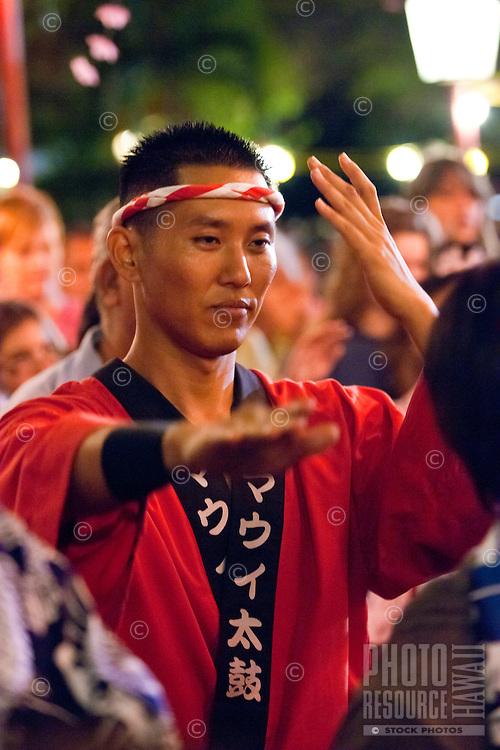 A man in traditional Japanese attire enjoys the annual obon dance at Lahaina Jodo Buddhist Mission, Lahaina, Maui