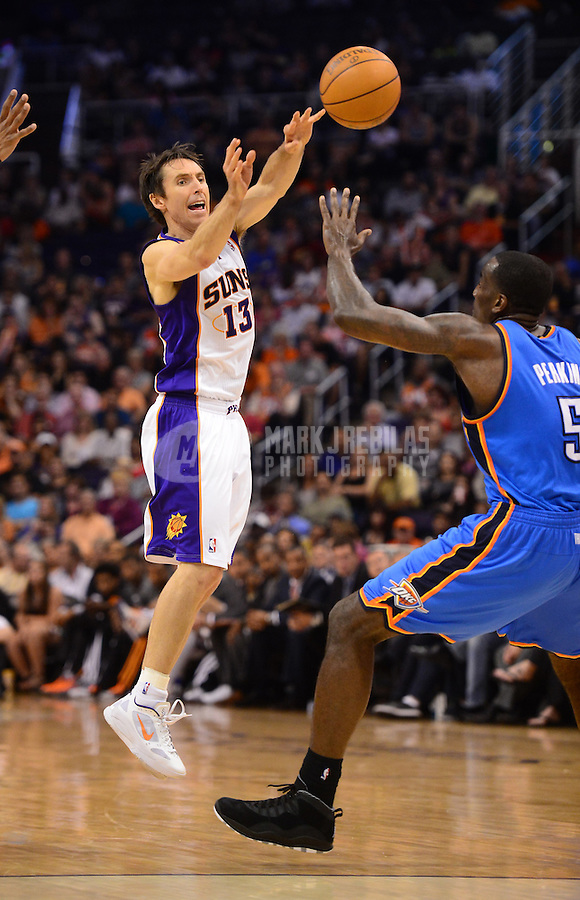 Apr. 18, 2012; Phoenix, AZ, USA; Phoenix Suns guard (13) Steve Nash passes the ball in the second half against the Oklahoma City Thunder at the US Airways Center. Mandatory Credit: Mark J. Rebilas-