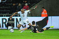 Andre Ayew of Swansea City under pressure from Tom Lockyer of Charlton Athletic during the Sky Bet Championship match between Swansea City and Charlton Athletic at the Liberty Stadium in Swansea, Wales, UK.  Thursday 02 January 2020