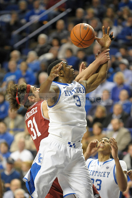 UK's Terrence Jones is fouled while rebounding during the second half of the University of Kentucky men's basketball game against Arkansas at Rupp Arena in Lexington, Ky., on 1/17/12. UK won the game 86-63. Photo by Mike Weaver | Staff