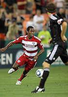 Carey Talley #8 of D.C. United watches Atiba Harris #16 of FC Dallas during an MLS match at RFK Stadium in Washington D.C. on August 14 2010. Dallas won 3-1.