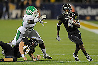 1 September 2011:  FIU's T.Y. Hilton (4), with the help from Wesley Carroll (13), evades North Texas' K.C. Obi (46) in the first half as the FIU Golden Panthers defeated the University of North Texas, 41-16, at University Park Stadium in Miami, Florida.