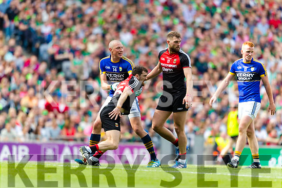 Kieran Donaghy Kerry has a tussle with Chris Barrett Mayo in the All Ireland Semi Final Replay in Croke Park on Saturday.
