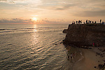 Tourists walk on fort ramparts at sunset in historic town of Galle, Sri Lanka, Asia