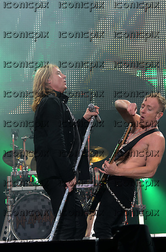 Def Leppard - vocalist Joe Elliott and guitarist Phil Collen performing live as the headline act on the Main Stage on Day 1 of the 2011 Download Festival at Donington Park UK - 10 Jun 2011.  Photo credit: George Chin/IconicPix