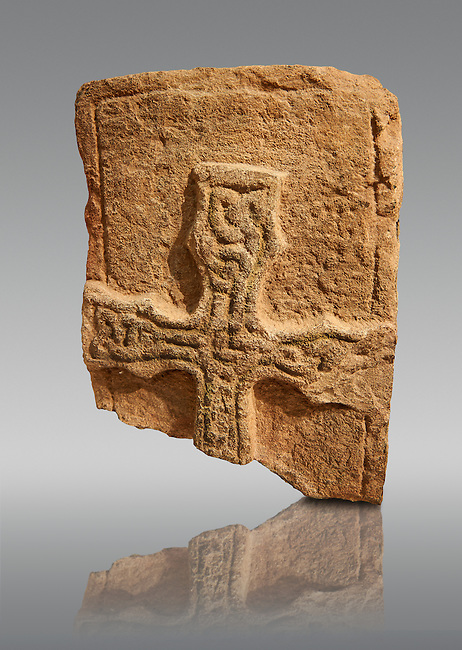 A typical Anglo Saxon grave cover raised cross fragment decporated with raised interlaced patterns from 800-899. Lindisfarne Abbey Museum, Northumbria, England