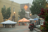 NWA Democrat-Gazette/BEN GOFF @NWABENGOFF<br /> Vendors secure their tents and goods as a sudden storm rolls in Friday, July 5, 2019, during First Friday on the Bentonville Square. The theme for July was 'Great Outdoors.'