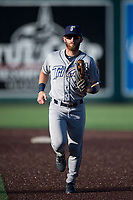 Tri-City Dust Devils left fielder Tyler Benson (3) jogs off the field between innings of a Northwest League game against the Everett AquaSox at Everett Memorial Stadium on September 3, 2018 in Everett, Washington. The Everett AquaSox defeated the Tri-City Dust Devils by a score of 8-3. (Zachary Lucy/Four Seam Images)