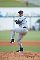Pensacola Blue Wahoos relief pitcher Alex Phillips (25) in action against the Birmingham Barons at Regions Field on July 7, 2019 in Birmingham, Alabama. The Barons defeated the Blue Wahoos 6-5 in 10 innings. (Brian Westerholt/Four Seam Images)