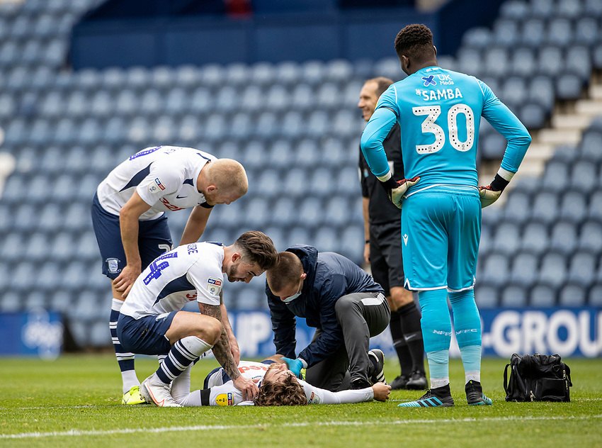 Preston North End's Sean Maguire (left) and Jayden Stockley (2nd left) check on injured team mate Ben Pearson as  Nottingham Forest's Brice Samba looks on <br /> <br /> Photographer Andrew Kearns/CameraSport<br /> <br /> The EFL Sky Bet Championship - Preston North End v Nottingham Forest - Saturday 11th July 2020 - Deepdale Stadium - Preston <br /> <br /> World Copyright © 2020 CameraSport. All rights reserved. 43 Linden Ave. Countesthorpe. Leicester. England. LE8 5PG - Tel: +44 (0) 116 277 4147 - admin@camerasport.com - www.camerasport.com