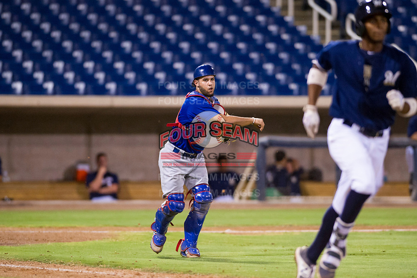 AZL Cubs catcher Richard Nunez (8) makes a throw to first base against the AZL Brewers on August 24, 2017 at Maryvale Baseball Park in Phoenix, Arizona. AZL Cubs defeated the AZL Brewers 9-1. (Zachary Lucy/Four Seam Images)