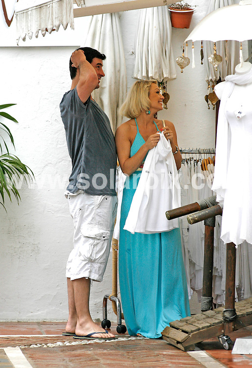 "**ALL-ROUND EXCLUSIVE PICTURES FROM SOLARPIX.COM**.**WORLDWIDE SYNDICATION RIGHTS**.Undefeated World Super Middleweight boxing Champion Joe Calzaghe 38, took his Strictly Come Dancing girlfriend Kristina Rihanoff 32, out for a romantic lunch in Orange Square, in the old town of Marbella this week. The ""Italian Dragon"" then took the beautiful Siberian dance instructor shopping. They were seen looking at rings in an antique jewellery shop and enjoyed an ice cream which they shared while walking through the back street. The couple have been spending a few days  at a luxury beach & Spa resort together, relaxing after Kristina's latest dance tour. .This pic: Joe Calzaghe & Kristina Rihanoff.JOB REF: 11232        AB/SF       DATE:   22.05.10.**MUST CREDIT SOLARPIX.COM OR DOUBLE FEE WILL BE CHARGED**.**MUST AGREE FEE BEFORE ONLINE USAGE**.**CALL US ON: +34 952 811 768 or LOW RATE FROM UK 0844 617 7637**."