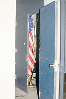 An American flag is seen backstage as Democratic presidential candidate and Massachusetts senator Elizabeth Warren speaks at a Town Hall campaign event in the Granite State Room in the Memorial Union Building at the University of New Hampshire in Durham, New Hampshire, on Wed., October 30, 2019. Per the campaign, approximately 625 people attended the event, which was part of Warren's 20th trip to the state since Jan. 2019.