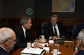 United States President George W. Bush talks to his national security team in the Pentagon before being briefed by senior Department of Defense (DoD) officials and military commanders on May 10, 2004.   From left to right: US Vice President Dick Cheney, President Bush, US Secretary of Defense Donald Rumsfeld, and US Secretary of State Colin Powell (partially obscured)<br /> Mandatory Credit: Jerry Morrison / DoD via CNP
