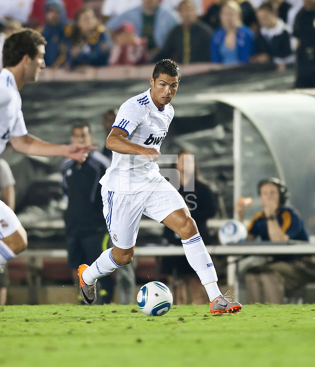 Real midfielder Cristiano Ronaldo (7) moves the ball up the pitch during the second half of the friendly game between LA Galaxy and Real Madrid at the Rose Bowl in Pasadena, CA, on August 7, 2010. LA Galaxy 2, Real Madrid 3.