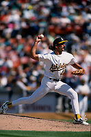 OAKLAND, CA - Dennis Eckersley of the Oakland Athletics pitches during a game at the Oakland Coliseum in Oakland, California on April 28, 1994. (Photo by Brad Mangin)
