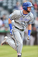 Hartford Yard Goats center fielder David Dahl (1) runs to first during a game against the Richmond Flying Squirrels at The Diamond on April 30, 2016 in Richmond, Virginia. The Yard Goats defeated the Flying Squirrels 5-1. (Tony Farlow/Four Seam Images)