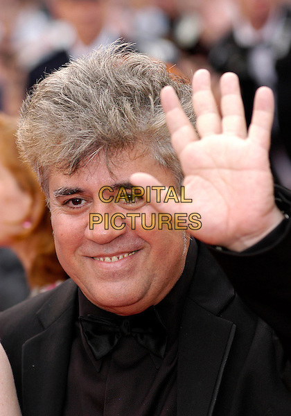 """PEDRO ALMODOVAR.""""Marie Antoinette"""" premiere screening 59th International Cannes Film Festival, France 24th May 2006.Ref: KRA.headshot portrait hand palm.sales@capitalpictures.com.www.capitalpictures.com.©Capital Pictures"""